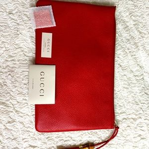 Never worn Gucci leather bamboo clutch
